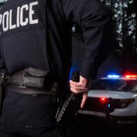 Police Officer grabbing his gun