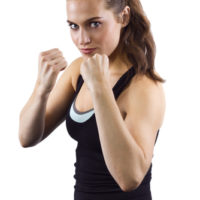 woman in a self defense stance
