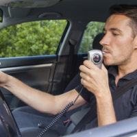 man-blowin-into-breathalyzer-jpg-crdownload
