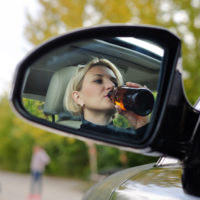 lady-drinking-while-driving