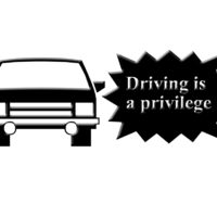 Sign that reads Driving is a privledge