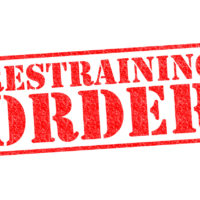 restraining order in red stamped over white background