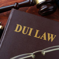 """Law book that reads """"DUI"""" on the front cover"""