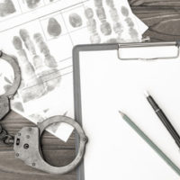 Hand cuffs and notepad for criminal prosecution