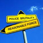 road signs that read police brutality and reasonable force